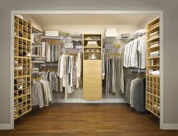bedroom large walk in closet ideas with wood flooring and rack