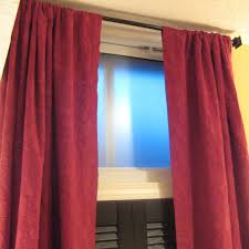 Maroon Curtains Maroon Curtain With Emboss Pattern Placed On The Black Steel Pole