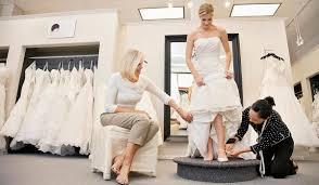 wedding dress maker traveller student in deposit row with dressmaker after cancelled