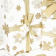 and gold christmas wrapping paper beautiful gold christmas curly pattern on background royalty
