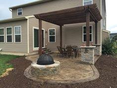 Concrete Backyard Patio by Stamped Concrete Patio With Pergola Gorgeous Backyard With A