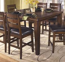 wood dining room set ashley furniture coviar dining table set in brown local ashley