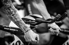 tattoos in hand person full of floral tattoo in hand riding exercise equipment
