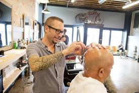 seattle barbers that do seahawk haircuts doug clark the haircuts aren t free and neither is the barber