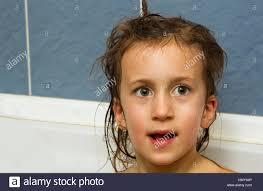 cute little girl washes her hair clean kid after shower children clean kid after shower children hygiene child taking bath little baby in a kitchen sink was