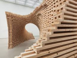 wave made from 9076 individual wooden pieces by hg architecture