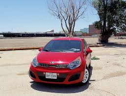 sweet kia rio painted in signal red color best subcompact car