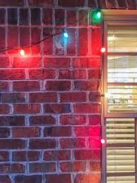 hanging christmas lights on brick walls how to hang christmas lights on brick homes with a glue gun