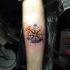 compass tattoo with a watercolor background by murat bilek