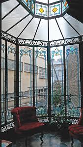 véranda sur cour intérieure réalisation sur verre nature cristal