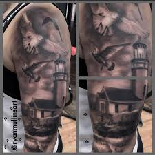 black and gray realistic light house with ocean and birds tattoo