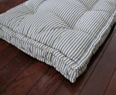 make your own bench cushion with piping following this easy sewing