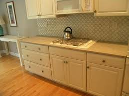 cream kitchen cabinets are a perfect match with ivory granite