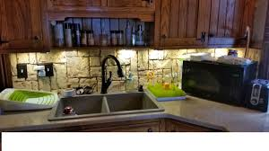 leaky faucet kitchen sink tiles backsplash white kitchen cabinets black countertops pink