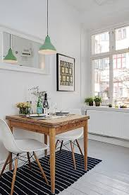 studio apartment dining table scandinavian studio apartment inspiring a cozy inviting ambiance