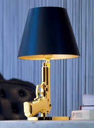 Gold Bedside Table Gun Bedside Table Lamp In Gold With Black Lamp Shade Flos