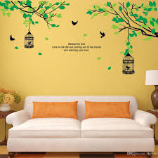 tree branches birdcage birds wall decals for living room bedroom high quality self adhesive matte vinyl stickers no tools required with little cost or effort you can decorate your home without the trouble or expense of