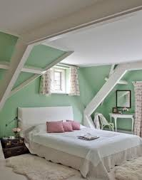mint green walls work so well in this traditional bedroom white