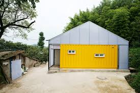 humanitarian low cost house with shipping container rooms springs