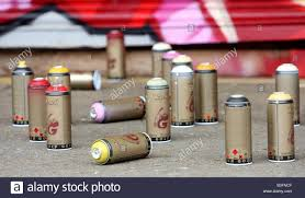Spray Cans Paint - some spray paint cans lay on the ground near a legal graffiti