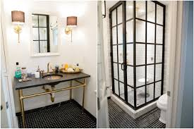 black and gold bathroom as well as light brown ceramic tile wall