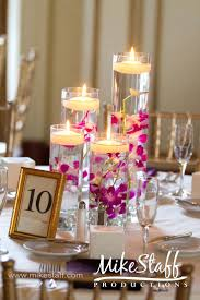 bright window candles gorgeous cylinder vase centerpieces with