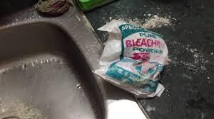 how to open blocked kitchen sink drain using bleaching powder