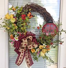 spring summer grapevine ladybug wreath with tulips and