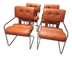 burnt orange tucroma leather and chrome dining chairs in mid