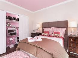 pink wall theme and brown bed cover on the bed added by white