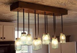 diy mason jar light with iron pipe mason jar chandelier nest of bliss