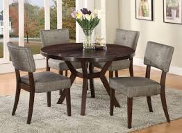 furniture round dark wood dining table with flower decoration