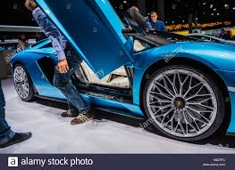 a man gets out of the lamborghini aventador s roadster at the