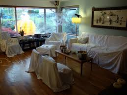 cover furniture with white sheets to look like haunted house