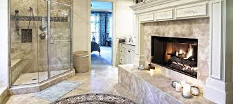 cool small bathroom design with stone fireplace and oval white
