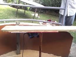 use circular saw as table saw genius jamaican carpenter uses hand circular saw as table saw youtube