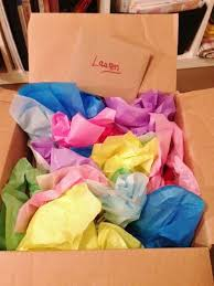 fill a box with small gifts individually wrapped for a birthday