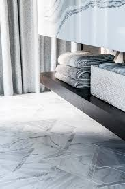 custom marble tile floor in a master bedroom suite by tineke