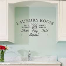 vinyl wall words typography sticker elegant wash dry fold repeat common words wall decals laundry room soft blue color paint below cabinet space