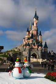 disneyland castle with decorations editorial photo