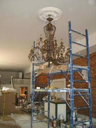 how to hang a chandelier with a swag how to hang a chandelier in a