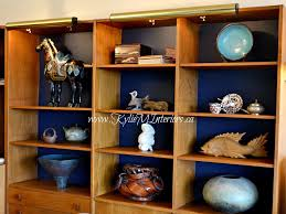 how to accessorize a bookshelf or bookcase with ornaments and plates