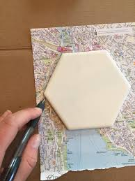 make coasters out of guide maps collected in various cities will