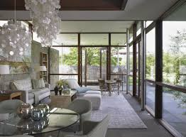 modern glamorous living room interior design that has glass door