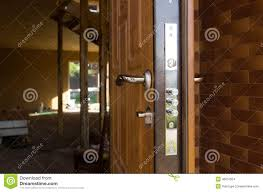 safety lock on a new wooden front door stock photo image 46057654