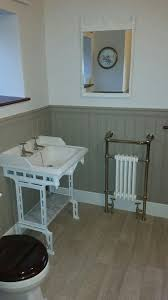 traditional bathroom in an old cottage wood paneling with gold