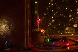 how to put christmas lights on a christmas tree correctly holiday lights in our front windows babytalk bungalow