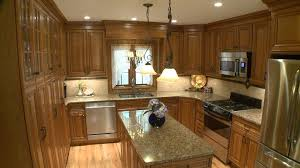 Mediterranean Kitchen Cabinets - omega cabinetry for a mediterranean kitchen with a light wood