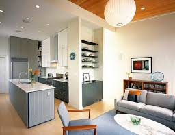 open plan kitchen design near family room with glass coffee table
