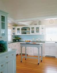 white kitchen cabinets with green countertops seaglass blue kitchen cabinets